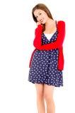 Mujer joven feliz en vestido y suéter punteados en a Imagenes de archivo