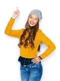 Mujer joven feliz o muchacha adolescente que destaca el finger Imagen de archivo