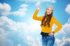 Mujer joven feliz o muchacha adolescente que destaca el finger Imagen de archivo libre de regalías
