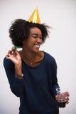 Mujer joven feliz que celebra Imagen de archivo libre de regalías