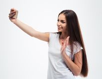 Mujer joven feliz que hace la foto del selfie Foto de archivo libre de regalías