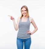 Mujer joven feliz que señala el finger lejos Imagen de archivo
