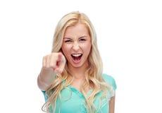 Mujer joven feliz que señala el finger a usted Imágenes de archivo libres de regalías