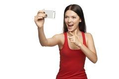 Mujer joven feliz que toma el selfie Fotografía de archivo libre de regalías
