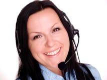 Mujer joven feliz que usa el auricular Imagenes de archivo