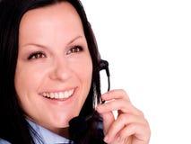 Mujer joven feliz que usa el auricular Fotografía de archivo