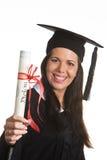 Mujer joven graduada con un diploma Imagenes de archivo