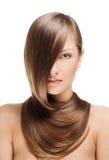 Mujer joven hermosa con el pelo brillante largo Fotos de archivo libres de regalías