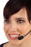 Mujer joven hermosa con el receptor de cabeza Fotos de archivo libres de regalías