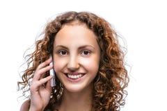 Mujer joven hermosa con el teléfono móvil Fotografía de archivo libre de regalías