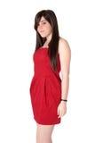 Mujer joven hermosa con la alineada roja Imagenes de archivo