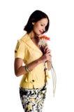 Mujer joven hermosa con la flor Imagen de archivo libre de regalías