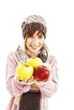 Mujer joven hermosa con la manzana. Estilo del invierno. Fotos de archivo