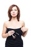 Mujer joven hermosa con las borlas, cuidado de piel Foto de archivo