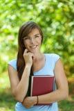 Mujer joven hermosa con los libros Foto de archivo