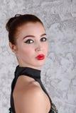 Mujer joven hermosa con maquillaje Foto de archivo libre de regalías