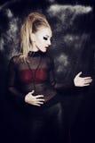 Mujer joven hermosa con maquillaje gótico Fotografía de archivo libre de regalías