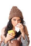 Mujer joven hermosa con síntoma de la gripe fotografía de archivo