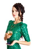 Mujer joven hermosa con un vidrio de champán Imagenes de archivo