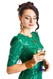 Mujer joven hermosa con un vidrio de champán Foto de archivo libre de regalías