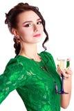Mujer joven hermosa con un vidrio de champán Foto de archivo