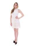Mujer joven hermosa del tamaño extra grande en el vestido aislado en blanco Foto de archivo libre de regalías