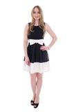 Mujer joven hermosa del tamaño extra grande en el vestido negro aislado en blanco Foto de archivo libre de regalías