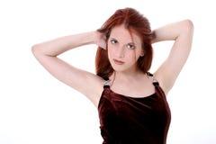 Mujer joven hermosa en alineada del terciopelo Foto de archivo libre de regalías