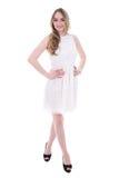 Mujer joven hermosa en el vestido aislado en blanco Foto de archivo