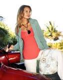 Mujer joven hermosa en moto Imagenes de archivo