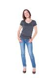 Mujer joven hermosa en pantalones vaqueros y camiseta Fotos de archivo
