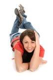 Mujer joven hermosa en suelo Fotografía de archivo libre de regalías