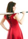 Una mujer con un bate de béisbol Fotografía de archivo libre de regalías