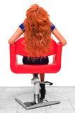 Mujer joven hermosa en una silla Foto de archivo libre de regalías