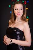 Mujer joven hermosa en vestido de noche Fotografía de archivo libre de regalías