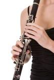 Mujer joven hermosa que juega el clarinet Foto de archivo libre de regalías