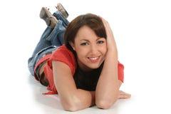 Mujer joven hermosa que pone en suelo Fotos de archivo libres de regalías