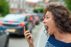 Mujer joven horrorizada con una expresión horrorizada Fotografía de archivo libre de regalías