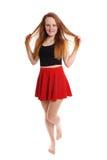 Mujer joven juguetona en mini falda Imagen de archivo libre de regalías