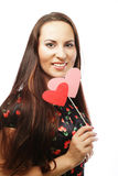 Mujer joven juguetona lista para el partido Imagen de archivo libre de regalías