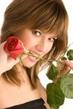 Mujer joven magnífica con una rosa Foto de archivo