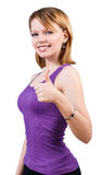 Mujer joven magnífica que muestra los pulgares grandes para arriba Fotografía de archivo