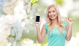 Mujer joven o adolescente feliz con smartphone Fotos de archivo