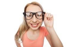 Mujer joven o adolescente feliz en lentes fotografía de archivo libre de regalías