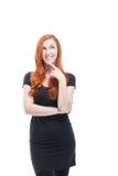 Mujer joven pensativa atractiva Imagenes de archivo