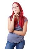 Mujer joven perdida en pensamiento Imagenes de archivo