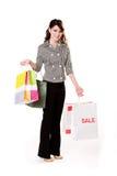 Mujer joven por completo de los bolsos de compras Fotografía de archivo
