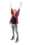 Mujer joven que celebra con sus brazos aumentados Imagen de archivo libre de regalías