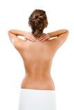Mujer que da masajes a la parte posterior del dolor Imagen de archivo