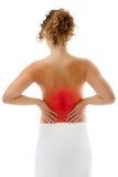 Mujer que da masajes a la parte posterior del dolor Foto de archivo